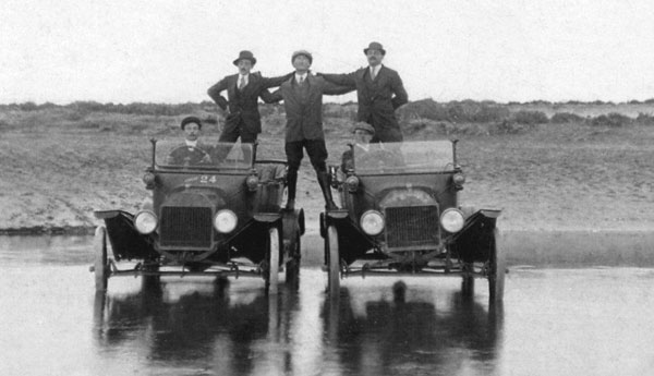 five men and two cars